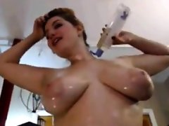 Thick and busty girl gets oiled up