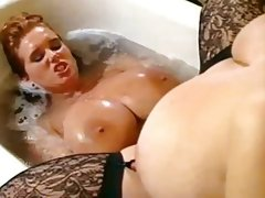 Two hot women with very big tits in..