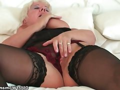 Curvy granny in black stockings rubs..