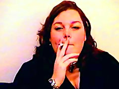 Chubby mature chick smokes on camera