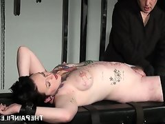 Punishment rack bondage of tattooed..