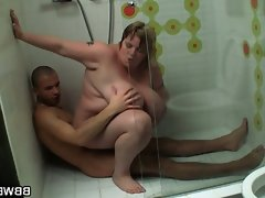 Huge titted lady rides in the shower